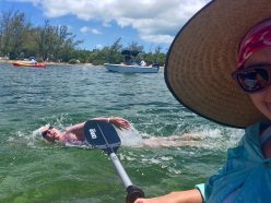 Making it past mile seven, Kristen Livengood finally has a moment to take a selfie with swimmer Cindy Walsh in the background. Walsh is a Triple Crown of Open Water Swimming completer.