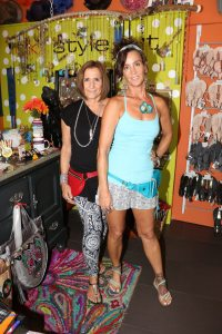 These aren't your mom's fanny packs. DK's Style Hut's owners Donna Kirchner and Mia Molek show off some of their new items in store, including these hip hip-bags made by Ruby Zarr and an exclusive line of orchid jewelry they just stocked.