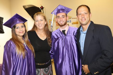 Laura Valenzuela is headed to Hillsborough Community College, pictured here with her mentor Cindy Bull, and Nelson Rojas, who will be attending Florida Gulf Coast, and his mentor, Chris Bull.