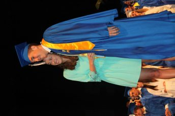 Grads receive awards – Scholarships further seniors' education goals - A person in a blue bed - Education