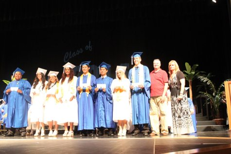 Grads receive awards – Scholarships further seniors' education goals - A group of people wearing costumes - Alex Mejia