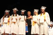 Grads receive awards – Scholarships further seniors' education goals - A group of people posing for the camera - Student