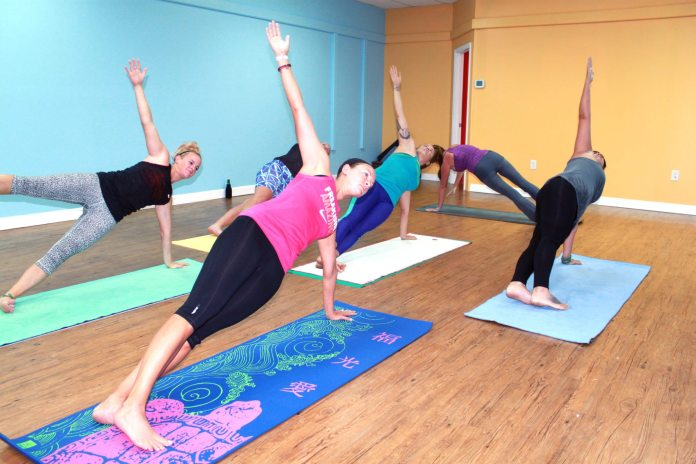 Yoga studio opens in Marathon – Sol Shine Yoga to offer variety of classes - A group of people jumping in the air - Yoga