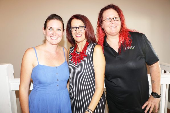 Firefly Owner Tricia Coyne with manager Janice Hudak and bartender Becca Larkin welcome the Girls Night Out ladies to the event.