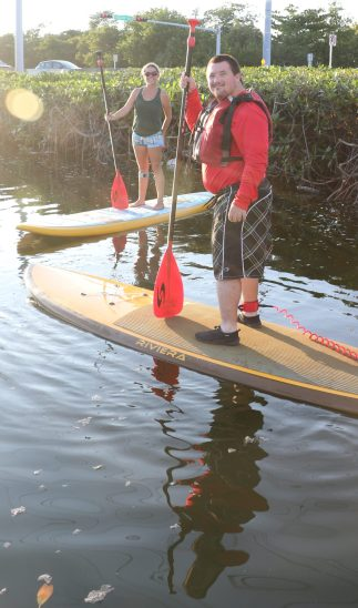 Athlete William Rainer paddles with Assistant Coach Lowe Matheson, who travels from the Middle Keys to practice at Lazy Dog with the athletes. He popped right up on the board like a pro.