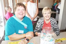 Deb Josiah, left, of Funkey Music, and Girls Night Out Founder Mary Lou Hoover check people into the event.