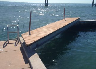 Pigeon Key unveils new 'shark' pool - A body of water next to the ocean - Water