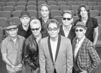 Huey Lewis coming to Key West – Concert is scheduled for early April - Huey Lewis et al. posing for a photo - Huey Lewis and the News