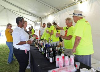 Beer and bubbly flows at fest - A group of people standing in a room - Race