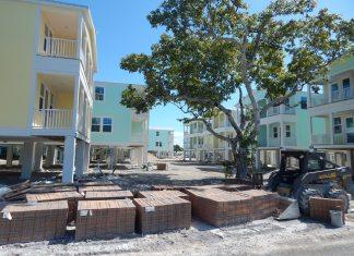 Marathon/Monroe County digest housing study - A large white building - House