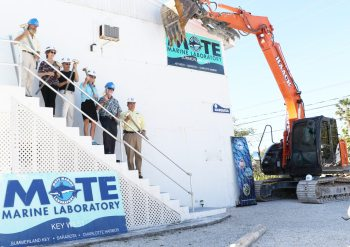 Officials and donors for Mote's planned new facility on Summerland Key celebrate the demolition of old buildings with Mote leaders and scientists: Dr. David Vaughan, Nancy Moskovitz, Rick Moskovitz, Elizabeth Moore, Dr. Michael Crosby and George Mazzarantani.