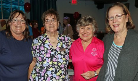Special Olympics Monroe County Coordinator Ruth Holland, with volunteers Pat Hart, Armida Averette, and Marcia Washam sell raffles and help donors sponsor athletes at the event.