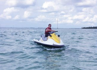 A Jet Ski tour can make a local feel like it's the very first time - A person riding a surf board on a body of water - Personal watercraft
