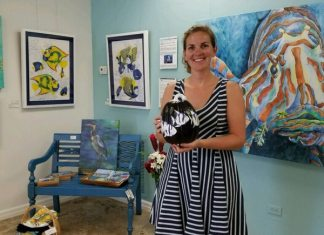 Purple Pumpkins: Art auction and gala raise funds for Rett Syndrome - Michelle Lowe standing in a room - Art