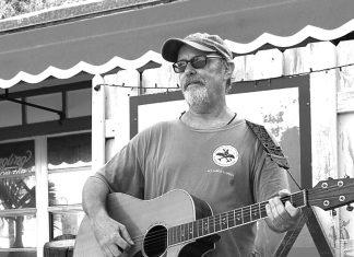 'Grateful Ted' Hyde - A man holding a guitar - Bass guitar
