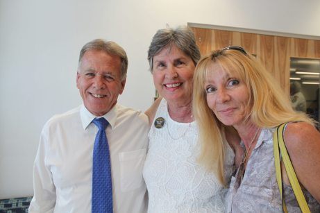 Marathon attorney, and the first mayor of Marathon, Bob Miller hugs Thea Ramsay and Beth Ramsay Vickrey.