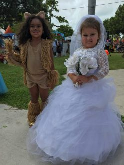 Leila and Gianna, both 4, wait to show off their costumes on stage.