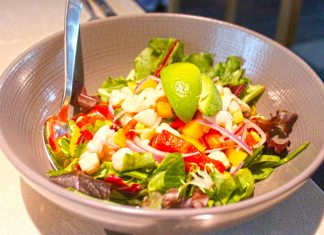 Seven Fish restaurant a culinary delight - A bowl of salad on a plate - Greek salad