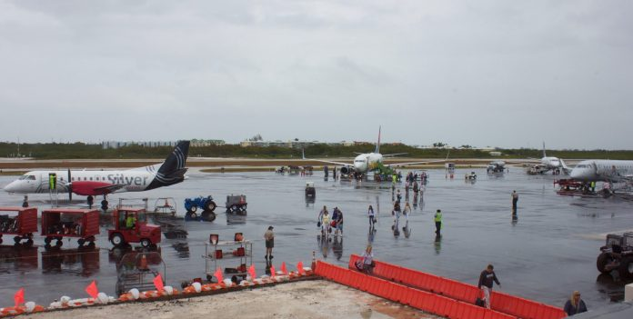 Checking in at EYW - A group of people sitting at a dock - Key West International Airport