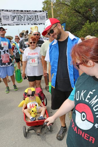 Little Pikachu Quora Fluker comes across the line with blazing speed, with mom Clarisa and dad Jeff.