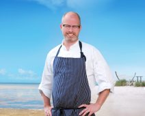 ReMARCable Surf & Turf Fundraiser - A man standing next to a body of water - Celebrity chef
