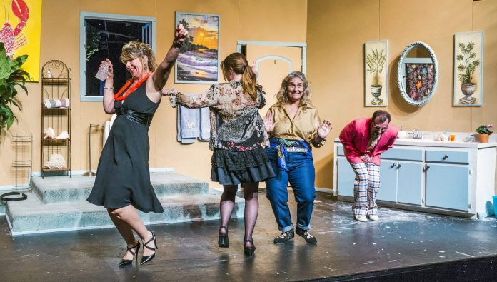 'Bathroom Humor' opens at MCT - A group of people standing in a room - Strobe light