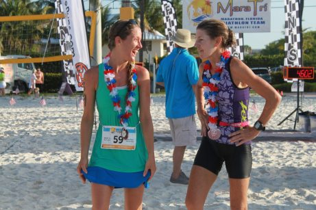 First-place female finisher Katharine Bahr, 30, congratulates Marathon's Laurie Grube, 53, at the finish line. They finished within three minutes of each other in the mini-sprint distance: 42:42 and 45:46.