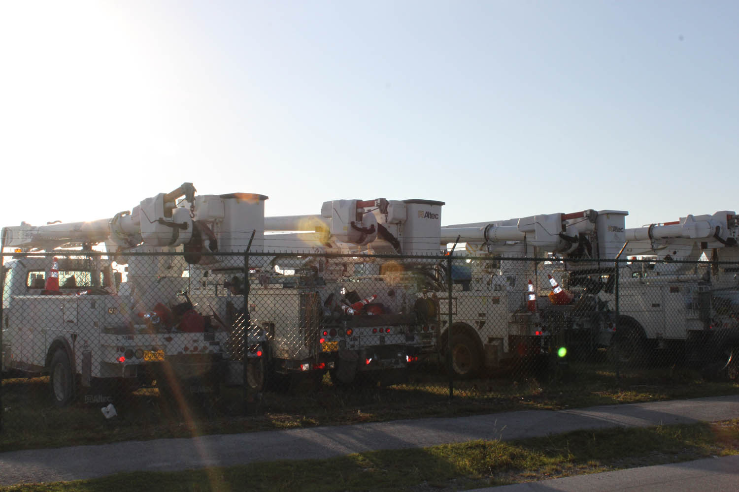 Crews of linemen are parking their rigs at the west end of Marathon airport.