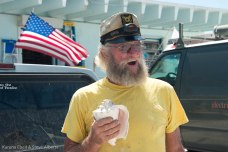 Capt. Eddie of the Conch Republic Navy gives the employees of Summerland Ace Hardware a conch-blow salute for the free food and water out front. Summerland Ace opened on Tuesday, following the storm.