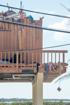 Clothing is snagged in the porch rails of this Ramrod Key home.
