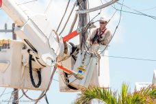 Electric workers strive to repair downed lines on Summerland Key.