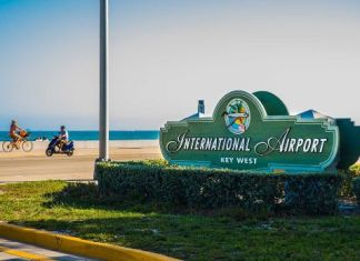 Monroe County closes KW airport, animal shelters; LKMC closes too - A sign on the side of the road - Key West International Airport