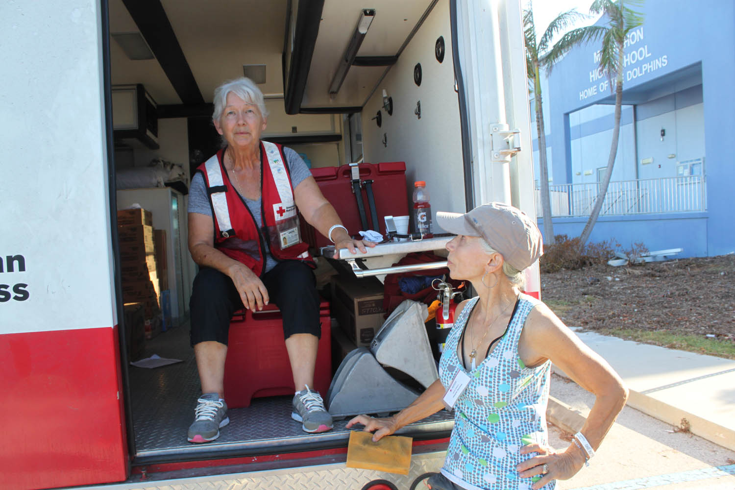 """Rose, left, and """"Shorty"""" are with the International Red Cross. On Sept. 17 they were staffing a medical truck parked outside the Marathon High School."""