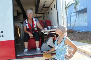 "Rose, left, and ""Shorty"" are with the International Red Cross. On Sept. 17 they were staffing a medical truck parked outside the Marathon High School."