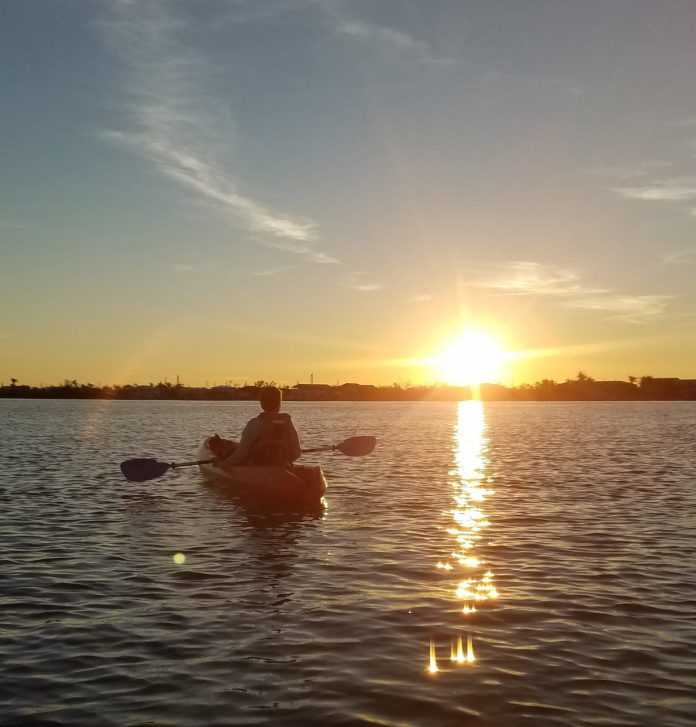 kayaking at sunset