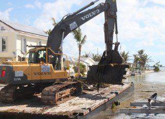 Marine debris removal begins in Keys canals - A large truck - Demolition