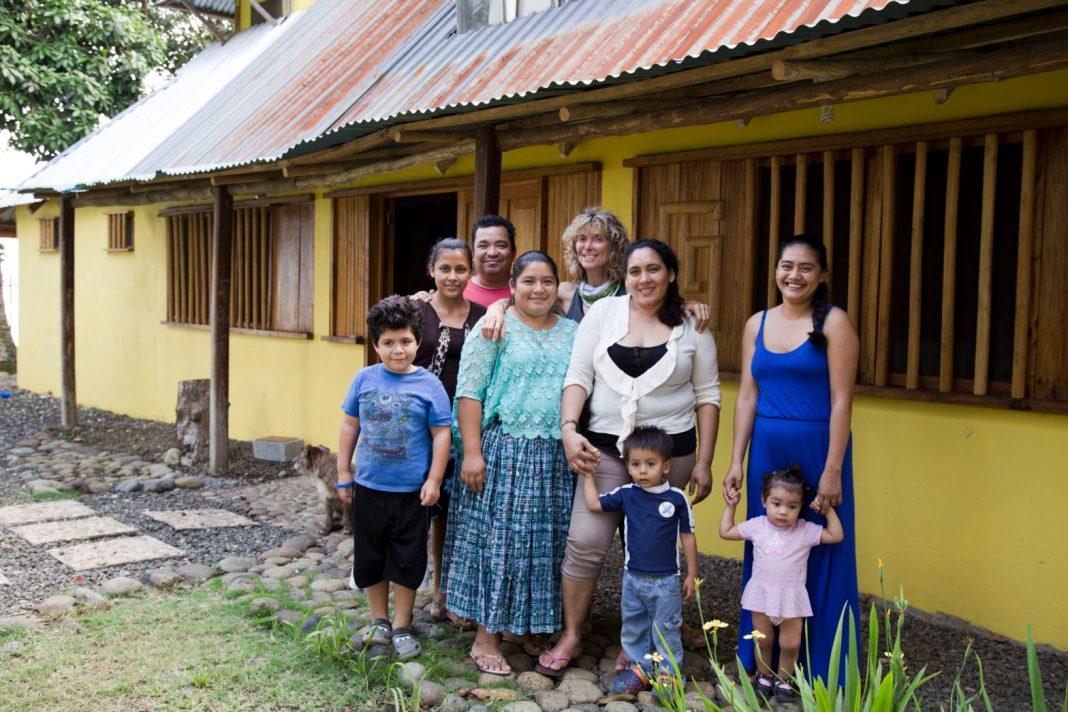 New Menu New Venue - A group of people standing in front of a house - Family
