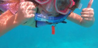 What's your kid doing this summer? - A person swimming in a pool of water - Snorkeling