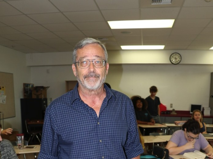 Key West High School teacher Mr. Kremer School's Out Forever… - A man standing in a room - KEY WEST HIGH SCHOOL