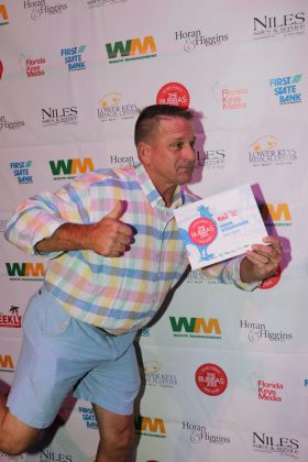 And the Winners Are! - A man standing in front of a refrigerator - Key West Theater