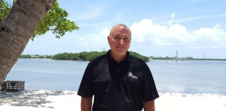 The Bee Man –Jason Beeman — banker, Conch — reflects on the life and times - A man standing next to a body of water - Sea