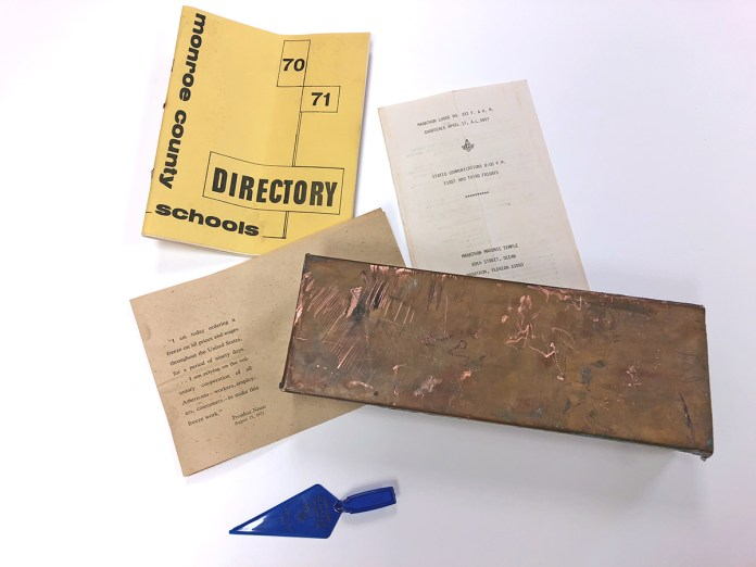 Masons' time capsule retrieved before elementary school demolished - A close up of a piece of paper - Product design