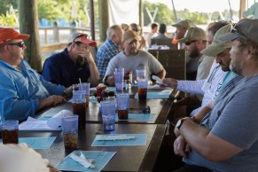 Veterans share stories and casual conversation over dinner.