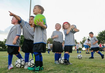 Jayden McLeod, 4, at left center, points out a rainbow in the sky to fellow Upper Keys American Youth Soccer Organization Region 864 6U teammate Tristan Hughes, 5, center, during the second practice of the 2018 season at Founders Park in Islamorada Friday, September 28, 2018. At far left is Tenley Banks, 4. And at right center are cousins Crew Stanley and Riff Loving, 4. Last year's season was cancelled due to Hurricane Irma. Photo by Doug Finger Photography