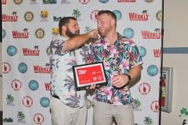 Marathon celebrates its best - A man holding a sign - Florida Keys