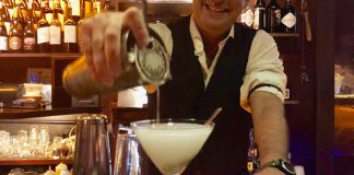 Berlin's: A Key West Classic Bar With a Twist of Something New - A person standing in front of a restaurant - Martini