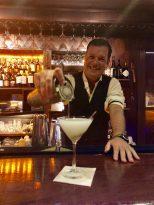 Gage Beaulieu pours a martini. SARAH THOMAS/Keys Weekly