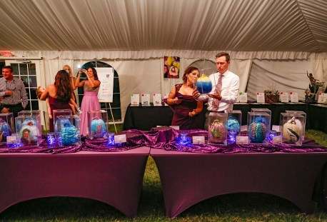Purple Pumpkin Gala - A group of people sitting at a table - Founders Park
