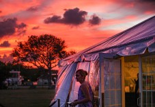 Musician Leah Sutter exits the tent set up at Founders Park. Photo by Doug Finger