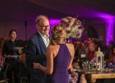 Purple Pumpkin Gala - A person standing on a stage - Wedding reception